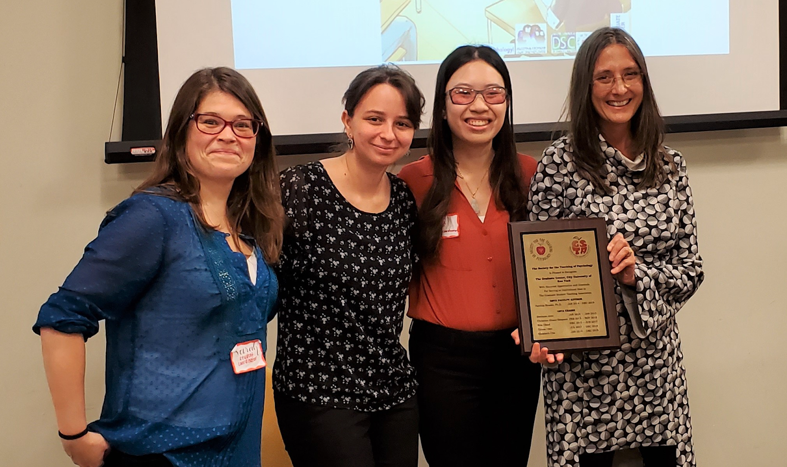 GSTA Blog Editor Sarah Frantz, Deputy Chair Jessica Brodsky, Chair Elizabeth Che, and Faculty Advisor Dr. Patricia Brooks sharing the STP Special Recognition Award at Pedagogy Day